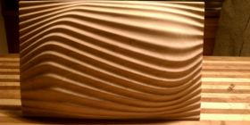 Carved waves on cherry wood