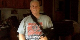 Don with sling on